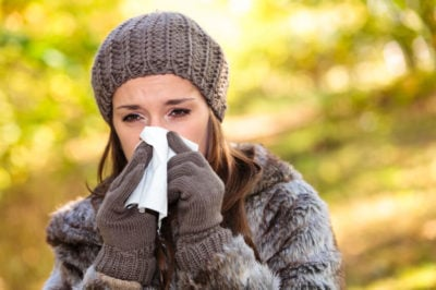 Woman suffering from a weakened immune system